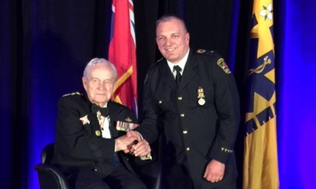 Honorary Lieutenant General Richard Rohmer present medal to Superintendent Chester Andraka  Lake Superior News