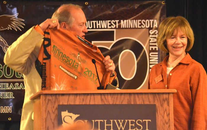 Brad Strootman of Marshall presents a Minnesota Governor's Pheasant Hunting Opener shirt to Lt. Gov. Tina Smith    Lake Superior News